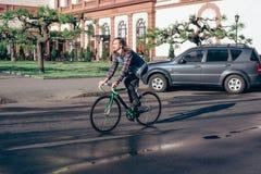 Man riding fixed-gear bicycle Stock Photos