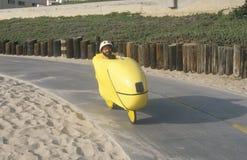 Man riding futuristic bicycle Stock Photos