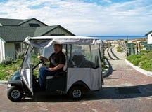 Man riding golf cart Stock Photography