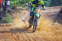 Man Riding Green Dirt Motorcycle during Daytime Royalty Free Stock Photos