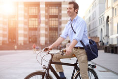Man riding his bicycle. In the city Royalty Free Stock Photo
