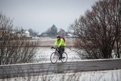 Man riding his bike. Klimovsk, Moscow Region, Russia - April 4th, 2015: Moscow cycling club Caravan event - 200km brevet(randonneuring, audax). Man riding his Royalty Free Stock Photography
