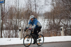 Man riding his bike. Klimovsk, Moscow Region, Russia - April 4th, 2015: Moscow cycling club Caravan event - 200km brevet(randonneuring, audax). Man riding his Stock Image