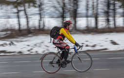 Man riding his bike. Panning. Klimovsk, Moscow Region, Russia - April 4th, 2015: Moscow cycling club Caravan event - 200km brevet(randonneuring, audax). Man Stock Images