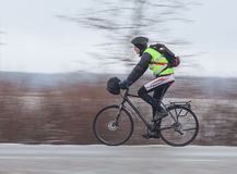 Man riding his bike. Panning. Klimovsk, Moscow Region, Russia - April 4th, 2015: Moscow cycling club Caravan event - 200km brevet(randonneuring, audax). Man Stock Image