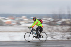 Man riding his bike. Panning. Klimovsk, Moscow Region, Russia - April 4th, 2015: Moscow cycling club Caravan event - 200km brevet(randonneuring, audax). Man Stock Photography