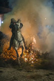 A man riding his horse jumping throug the fire Royalty Free Stock Photography