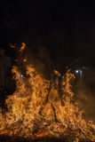 A man riding his horse jumping throug the fire Stock Photography
