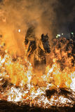 A man riding his horse jumping throug the fire Royalty Free Stock Photo