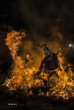 A man riding his horse jumping throug the fire Stock Image