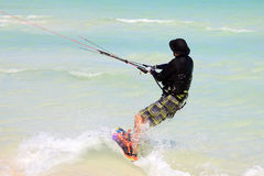Man riding his kiteboard. Royalty Free Stock Photography