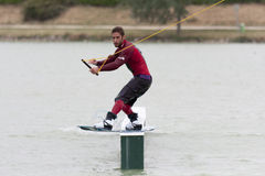 Man riding his wakeboard. ISLE-JOURDAIN, FRANCE - MAY 27, 2011: Wakeboarding on a lake at the International Wake'n Country on may 27, 2011, , Isle-Jourdain stock photo