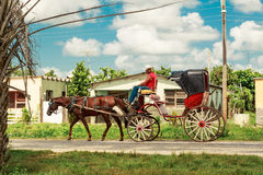 Man riding  on a horse-drawn carriage  Royalty Free Stock Images