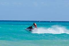 Man riding jet ski Royalty Free Stock Images