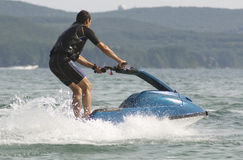 Man riding a jet ski Stock Photos