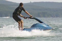 Man riding a jet ski Stock Photos