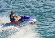 A man riding a jet ski Stock Photography
