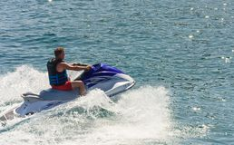 A man riding a jet ski (scooter) Royalty Free Stock Photo