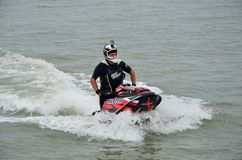Man riding jet skier in wet suit Royalty Free Stock Photos