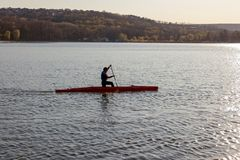 A man is riding a kayak stock photography