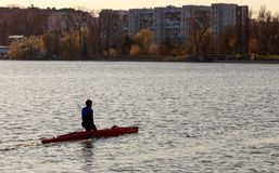 A man is riding a kayak royalty free stock photography