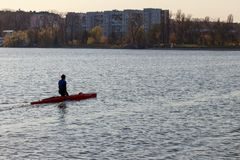 A man is riding a kayak stock images