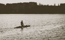 A man is riding a kayak royalty free stock images