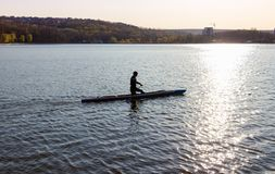 A man is riding a kayak royalty free stock photo