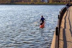 A man is riding a kayak royalty free stock photos