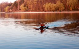 A man is riding a kayak stock image