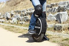South Korea Seoul - 03.14.2019: man riding a monowheel, electric unicycle close up, outdoors stock photo