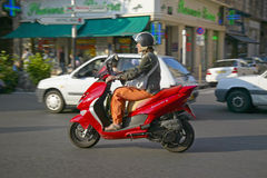 Man riding moped in Nice, France Royalty Free Stock Photo