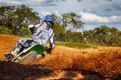 Man Riding Motocross Dirt Bike on Track stock photos