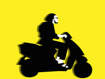 Man riding a motor scooter Stock Image