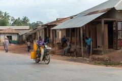 Man riding motorbike on Zanzibar village street Stock Images