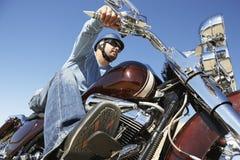Man Riding Motorcycle stock photo