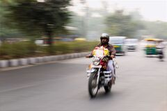 Man Riding on Motorcycle Stock Image