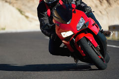 Man riding motorcycle in asphalt road curve with rural Royalty Free Stock Photography