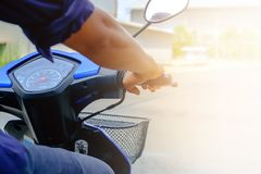 A man riding motorcycle on blurred concrete street road backgrou. Nd with sun light effect for vehicle and transportation concept Royalty Free Stock Photo