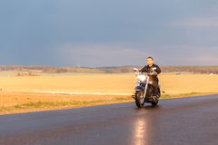 Man riding a motorcycle stock photography