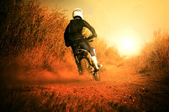 Man riding motorcycle in motorcross track use for people activit Stock Images