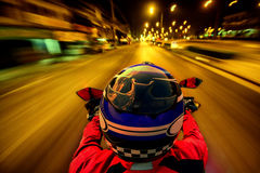 Man riding motorcycle on night road Royalty Free Stock Image