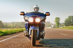 Man riding a motorcycle on an open road Royalty Free Stock Photo