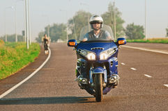 Man riding a motorcycle on an open road Royalty Free Stock Images