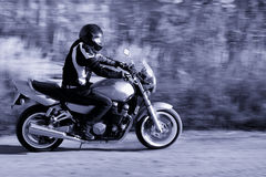 Man riding a motorcycle on the road stock photo