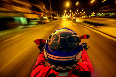 Man is riding a motorcycle on the road Stock Images
