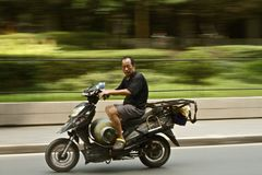 Man Riding Motorcycle on Road during Daytime Stock Photos