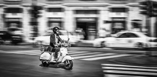 Man Riding Motorcycle at the Street of Rome Royalty Free Stock Image