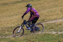 Man riding mountain bicycle downhill stock photos