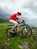 A man riding a mountain bike Stock Images